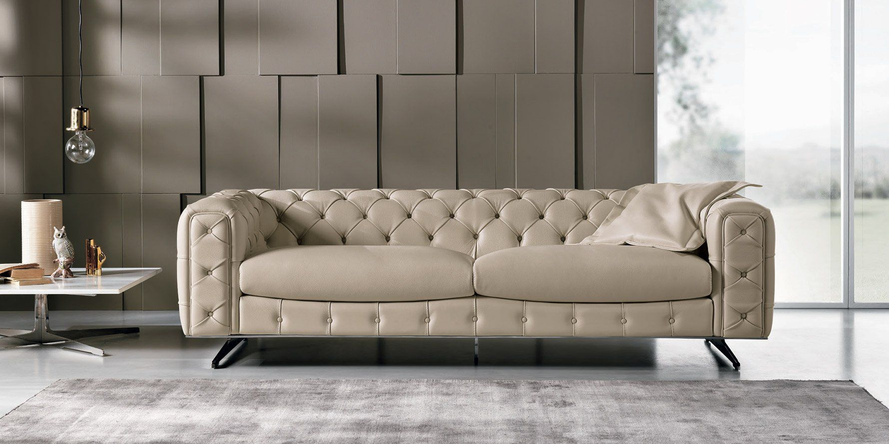 The ingrid sofa and loveseat from max divani italy tufted Sleek sofa set designs