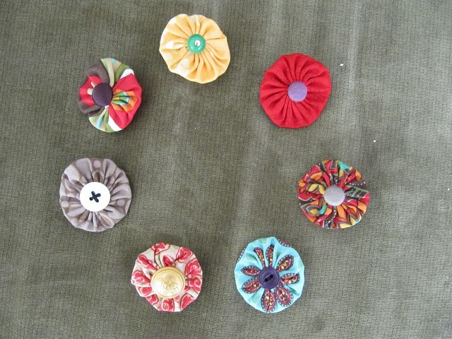 Hair clips I made from fabric circles, tiny alligator clips, and buttons from my button stash.