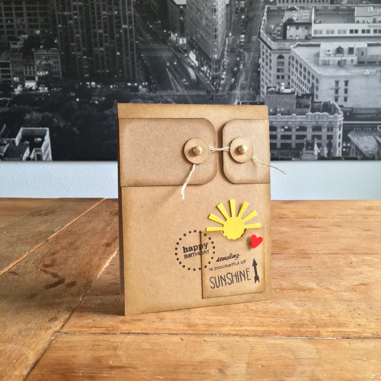 "Pocketful of Sunshine Card. Stamps: Neat & Tangled (""My Sunshine""), Wplus9 (""A Pocketful""); dies: L'il Inker (""Large Sun""); punch: SU (""Heart to Heart""); ink: Ranger, SU; Glossy Accents; twine and brads from my stash."