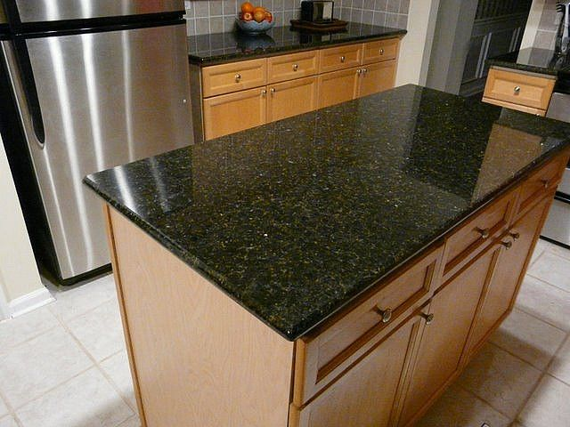 Uba Tuba Granite Countertop installed in Charlotte NC Uba Tuba Granite Countertops In Kitchen on lowe's granite countertops kitchen, christian clive luxury kitchen, corner countertop cabinet for kitchen,