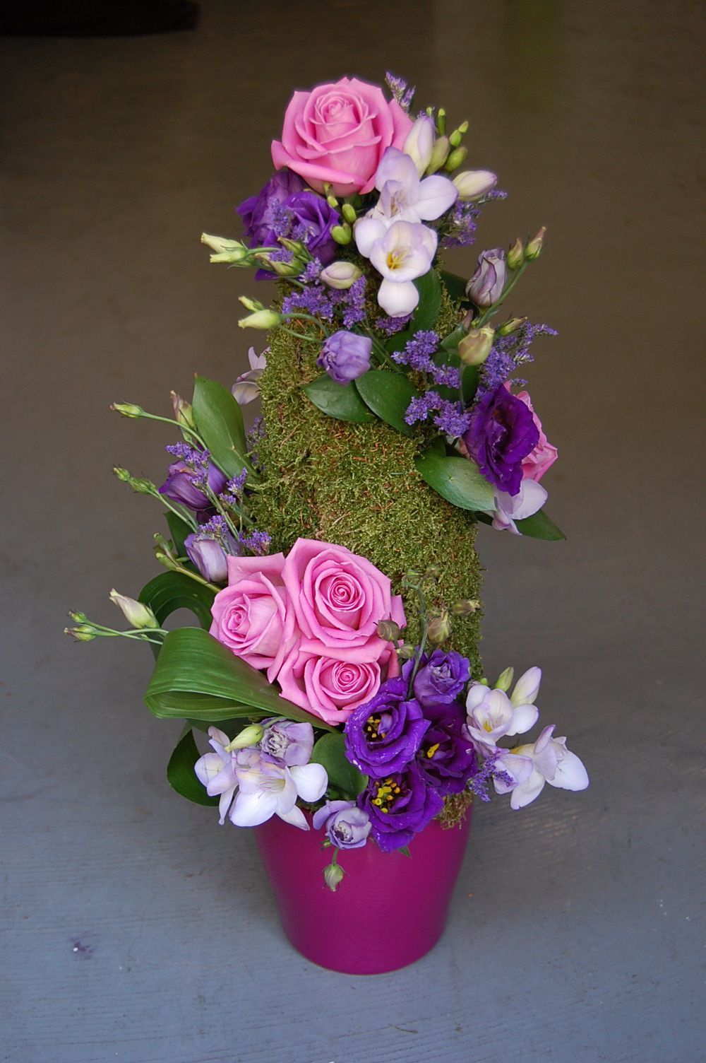 Cone moss with freesias, roses (Aqua) and lisianthus. By