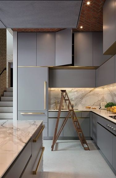 Govotsis: A matt lacquer kitchen with brass cladding from Roundhouse Design #greykitcheninterior