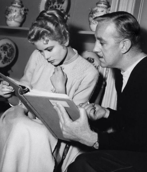 """Grace reading with her friend the actor David Niven behind the scenes of """"The Swan"""" - 1955."""