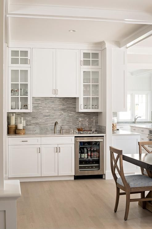 Built in dining room wet bar features white shaker - Built in bar cabinets ...