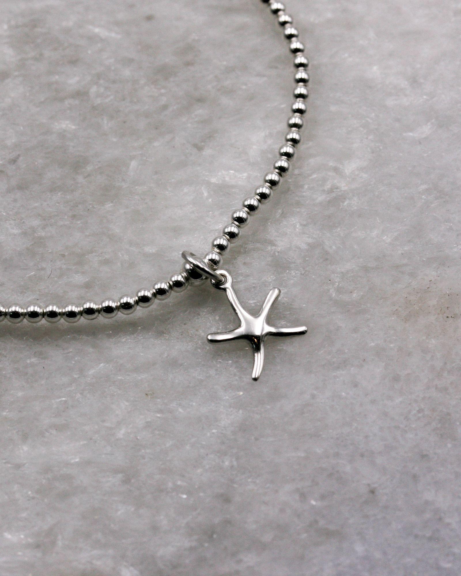 Beaded Starfish Charm Bracelet in sterling silver.