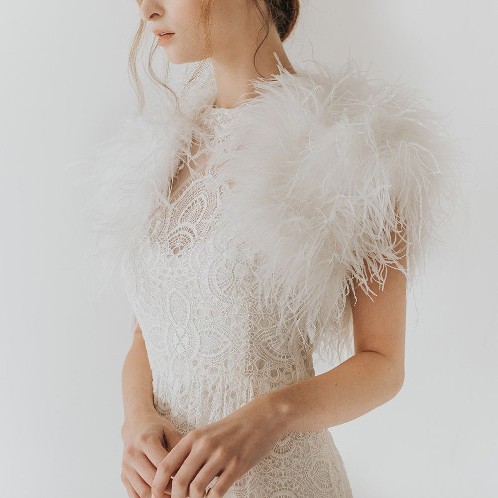 3973d32c3c2c Ivory ostrich feather bridal bolero Add a glamorous twist to bridal attire  with this ostrich feather bolero shrug.