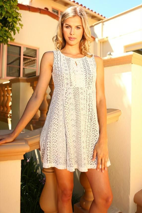 c977bcf46773 This short lace dress is lined with a striped material on the inside. It is  great for parties! - Model is wearing a size Small - Self  65% Acrylic 35%  ...