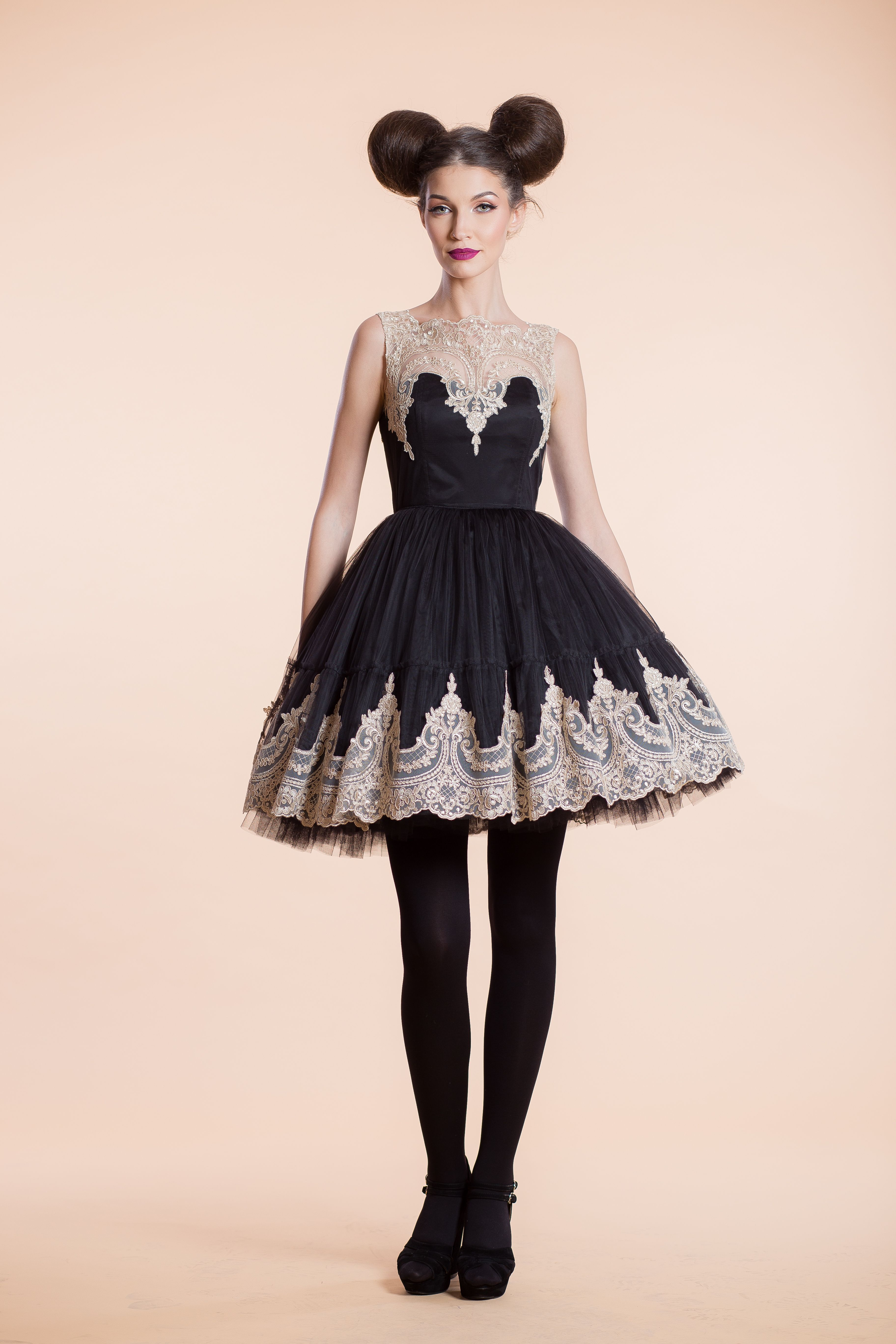 This dress uses a mix of black coffee syrup, foamy tulle and ...