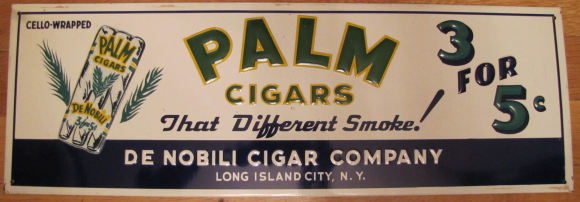 Sign advertising for Palm Cigars. That Different Smoke is stated across the center of the sign.