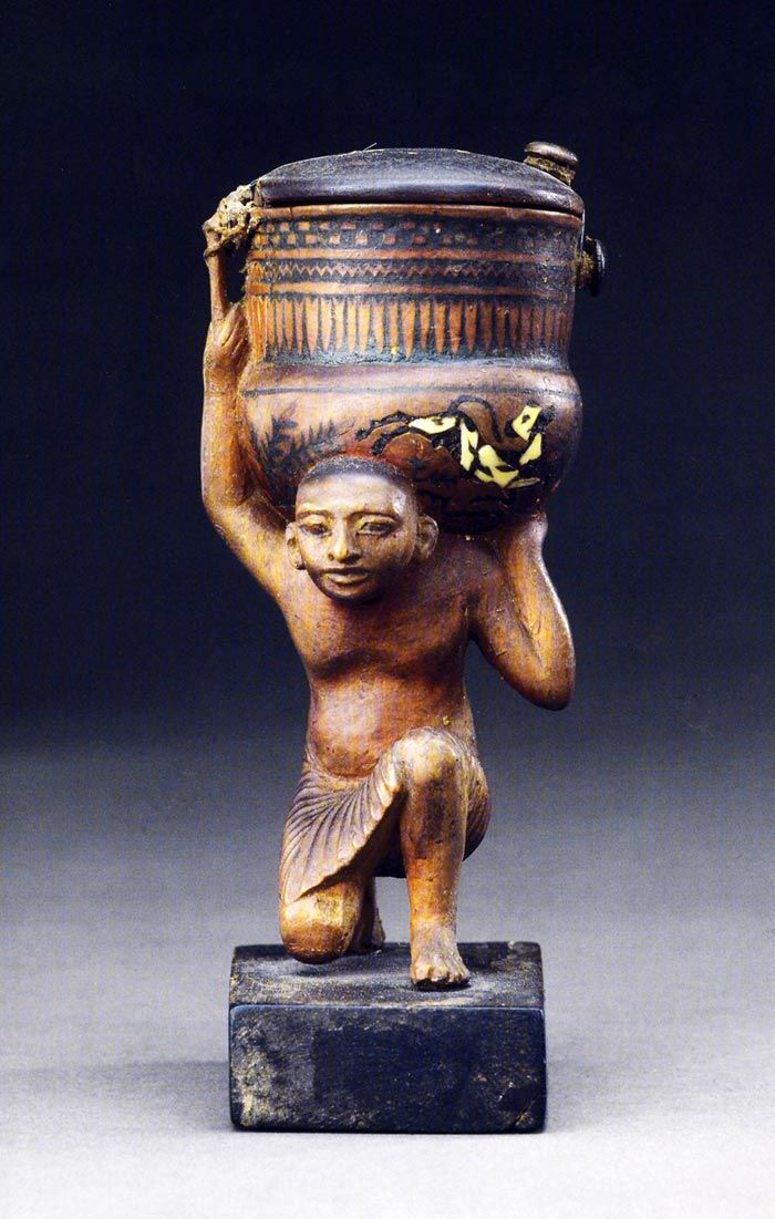 *EGYPT~Front view of an ointment of Siamun.Photo taken from Tutankhamun catalog.Although the objects linked to the world of cosmetics were used in the everyday level,some of them also show highly symbolic iconographic content +is likely to have a ritual use votive well.And the truth is that the ointment maker of Siamun shows some elements that could perhaps give a reading of transcendent character.It is,above all,the image of calves,three in the bottom of the jug and one on top of the lid.