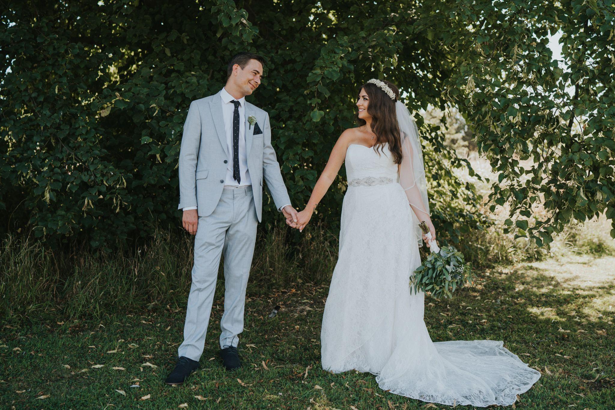 Wedding portraits of boho bride and groom smiling alternative