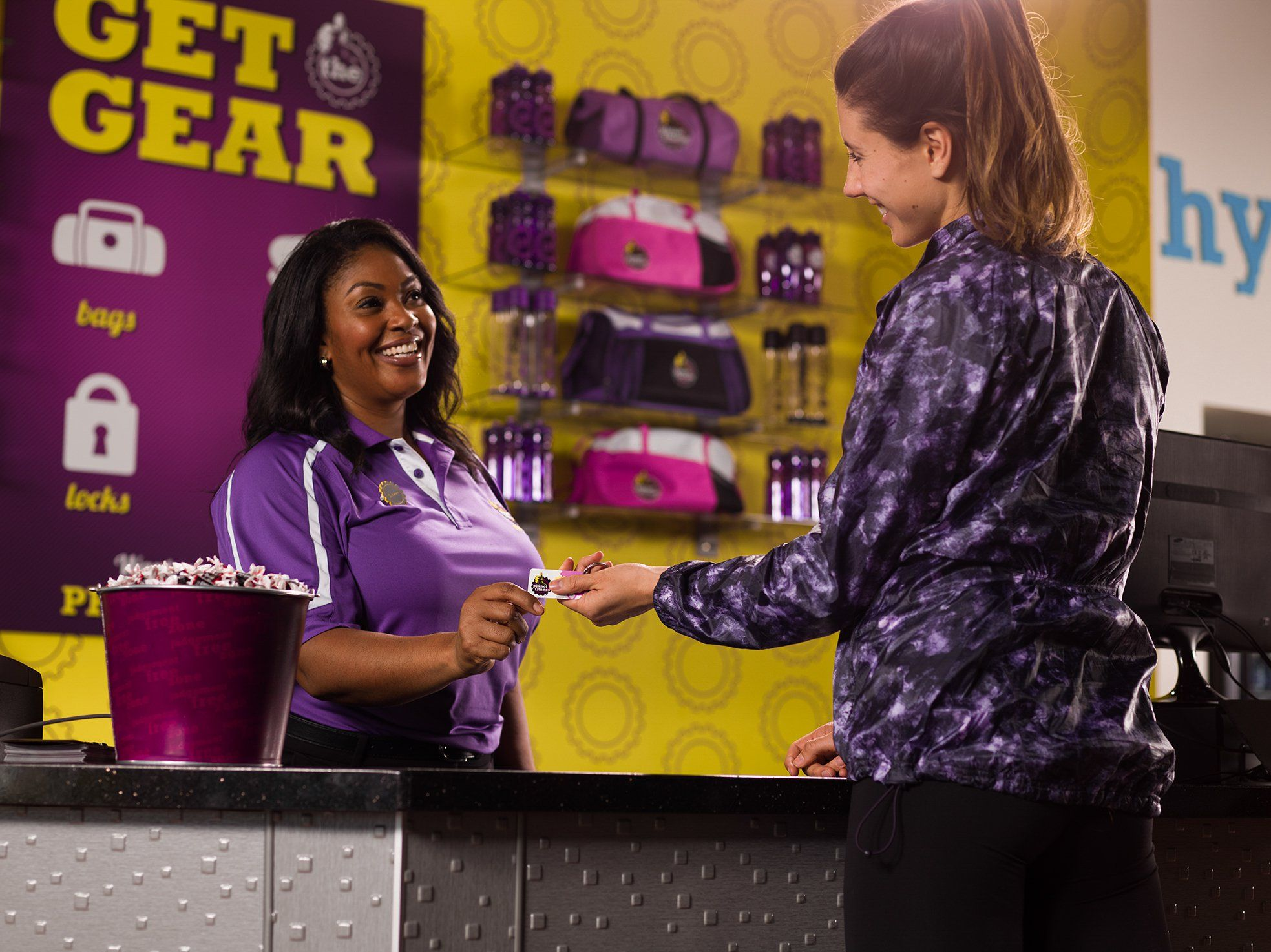 Woman Checking In At The Front Desk Of A Planet Fitness Gym Planet Fitness Workout Planet Fitness Gym Fitness Tips