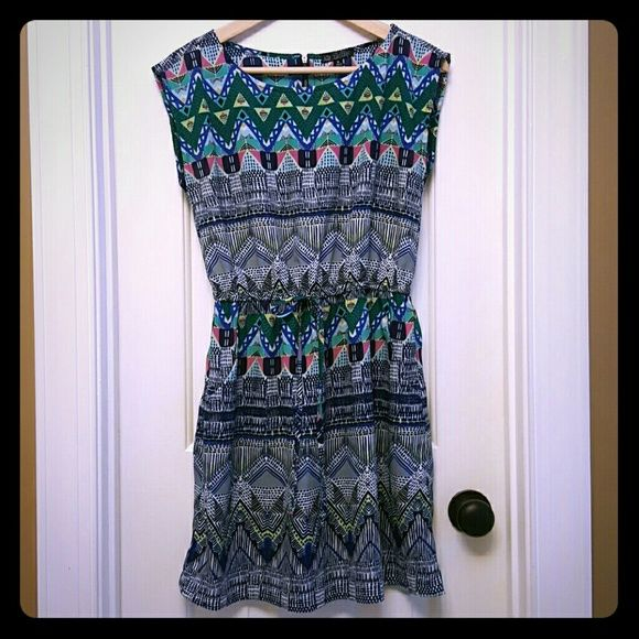Tribal Print mini dress BeBop size M, tribal Print dress. Elastic waist drawstring doesn't cinch but is just a tie for effect. Built in pockets. Back external zipper.  Very cute for summer.  Worn twice, perfect condition no flaws. Just a tad small for me now. BeBop Dresses Mini