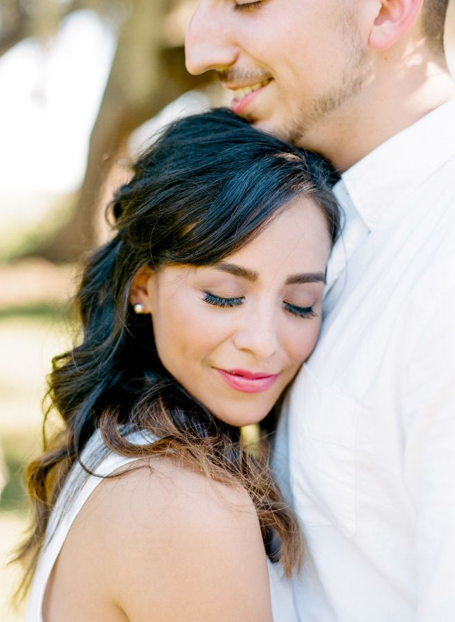 Sweet Brazos Bend Engagement Session: http://www.stylemepretty.com/little-black-book-blog/2015/11/02/glowing-brazos-bend-engagement-session/ | Photography: Dana Fernandez - http://www.danafernandezphotography.com/