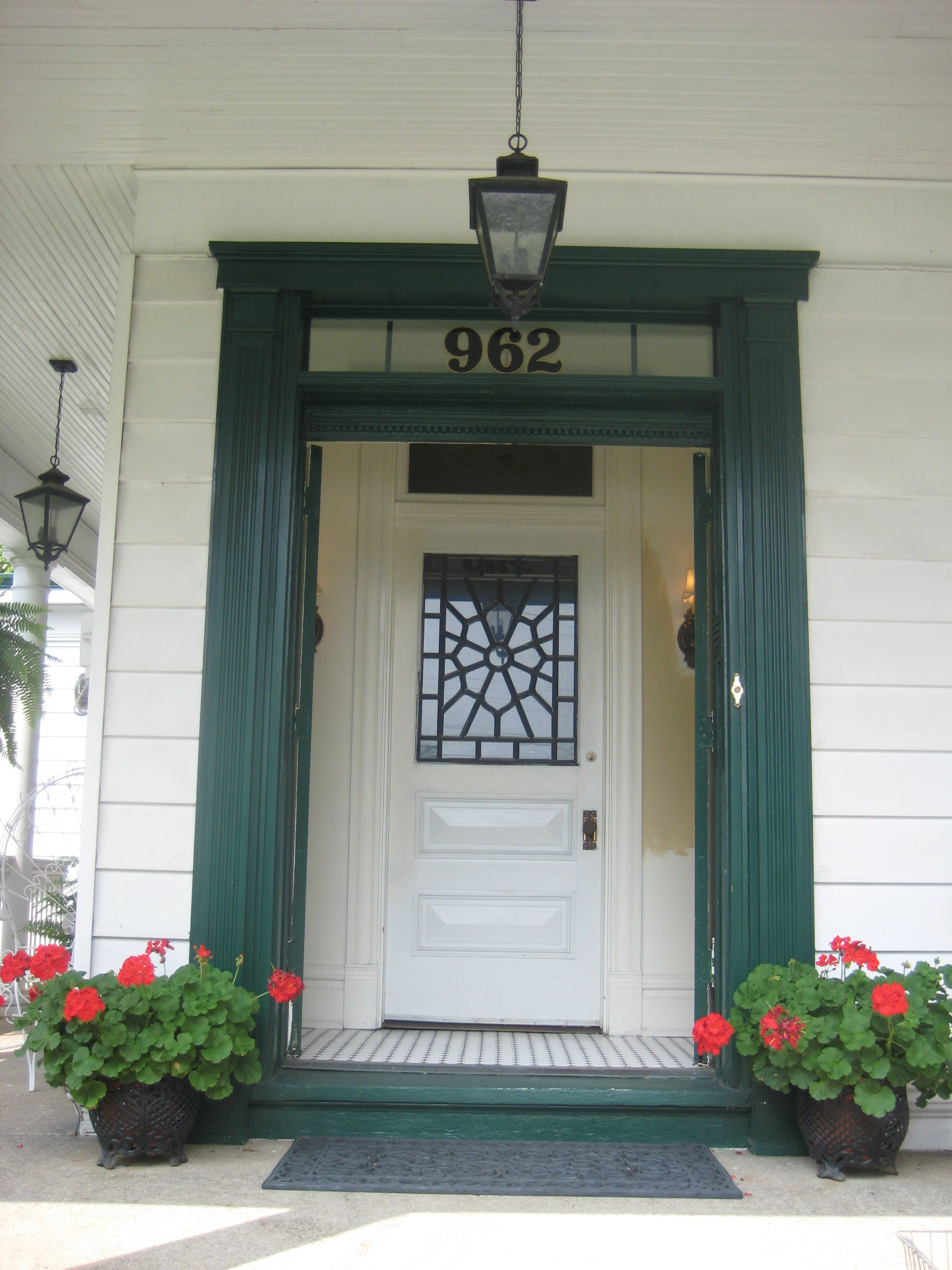 1902 Front entry Narrow double doors open to weather lock