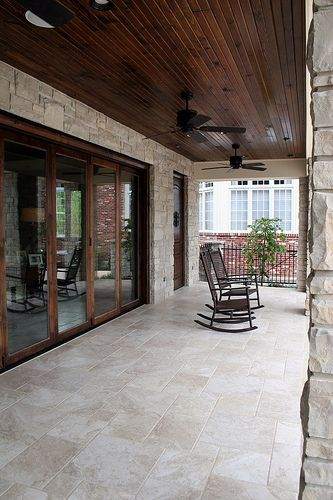 covered patio with wood ceiling stone