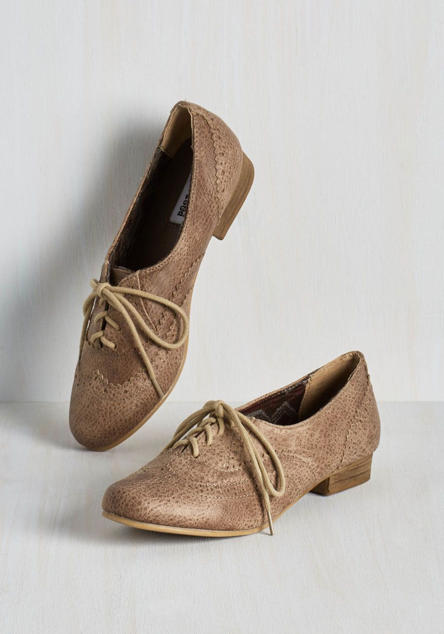 Dapper Days Flat in Cappuccino. From modish mornings to dashing evenings, youre a classic act in these taupe-brown Oxford flats. #tan #modcloth