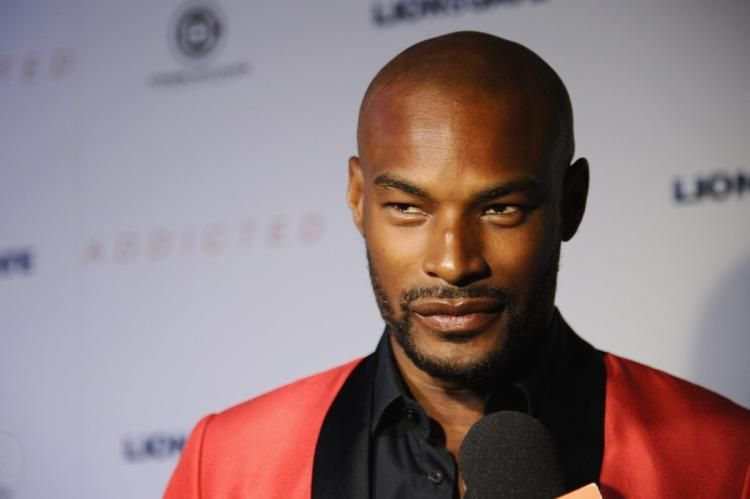Model Tyson Beckford pulled a gun out on a man serving him a lawsuit