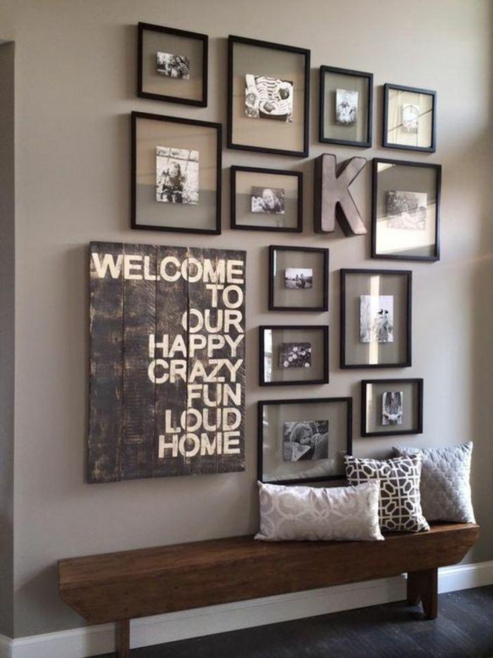 idee deco hall d entree maison avec des cadres noirs aux photos de diverses tailles