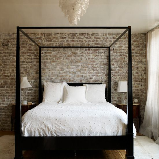 A Brick Wall And Simple Four Poster Bed Create Masculine Bedroom