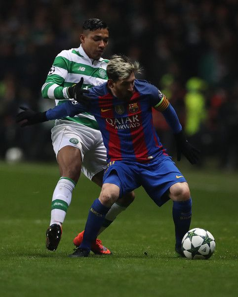 Emilio Izaguirre of Celtic vies with Lionel Messi of Barcelonal during the UEFA Champions League match between Celtic FC and FC Barcelona at Celtic Park Stadium on November 23, 2016 in Glasgow, Scotland.
