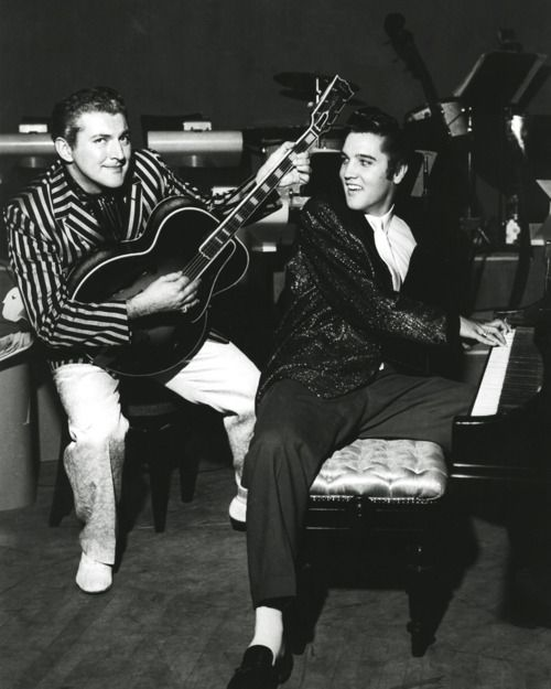 At their first meeting backstage at the Riviera Hotel in 1956, Liberace and a young Elvis Presley swapped jackets and instruments to ham it up for the camera.