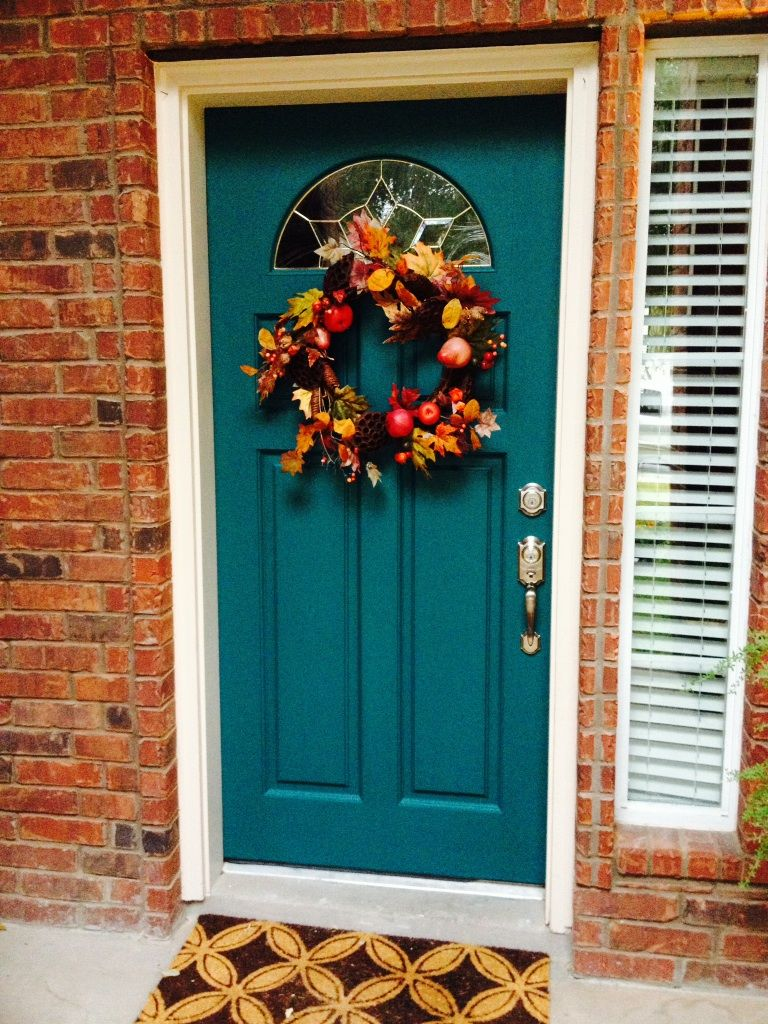 Teal painted front door with red bricks the first thing for Wood doors painted white