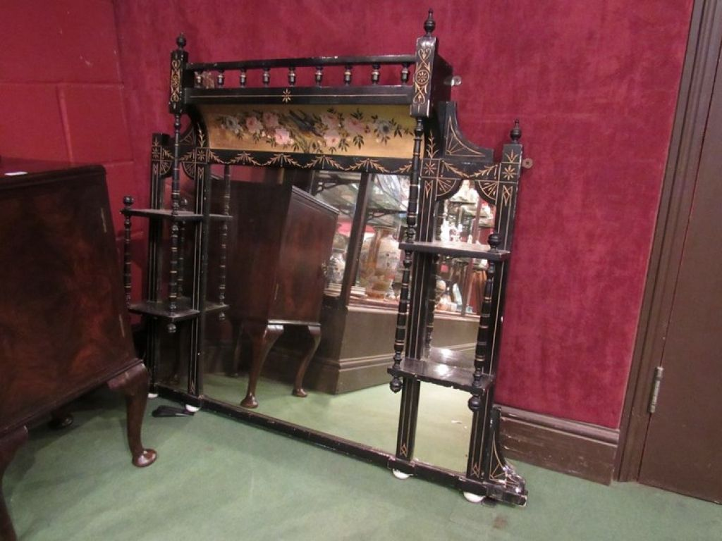Lot no: 181. An aesthetic movement ebonised and gilded over mantel mirror, bird and flower design