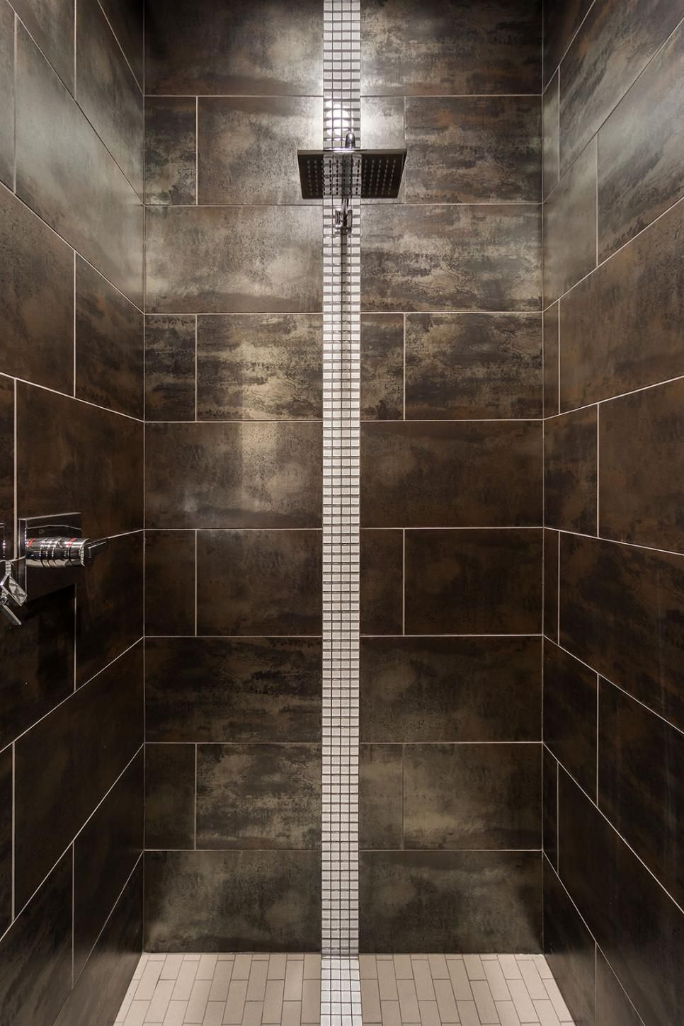 Slate gray tile surrounds this stunning, contemporary walk-in shower ...