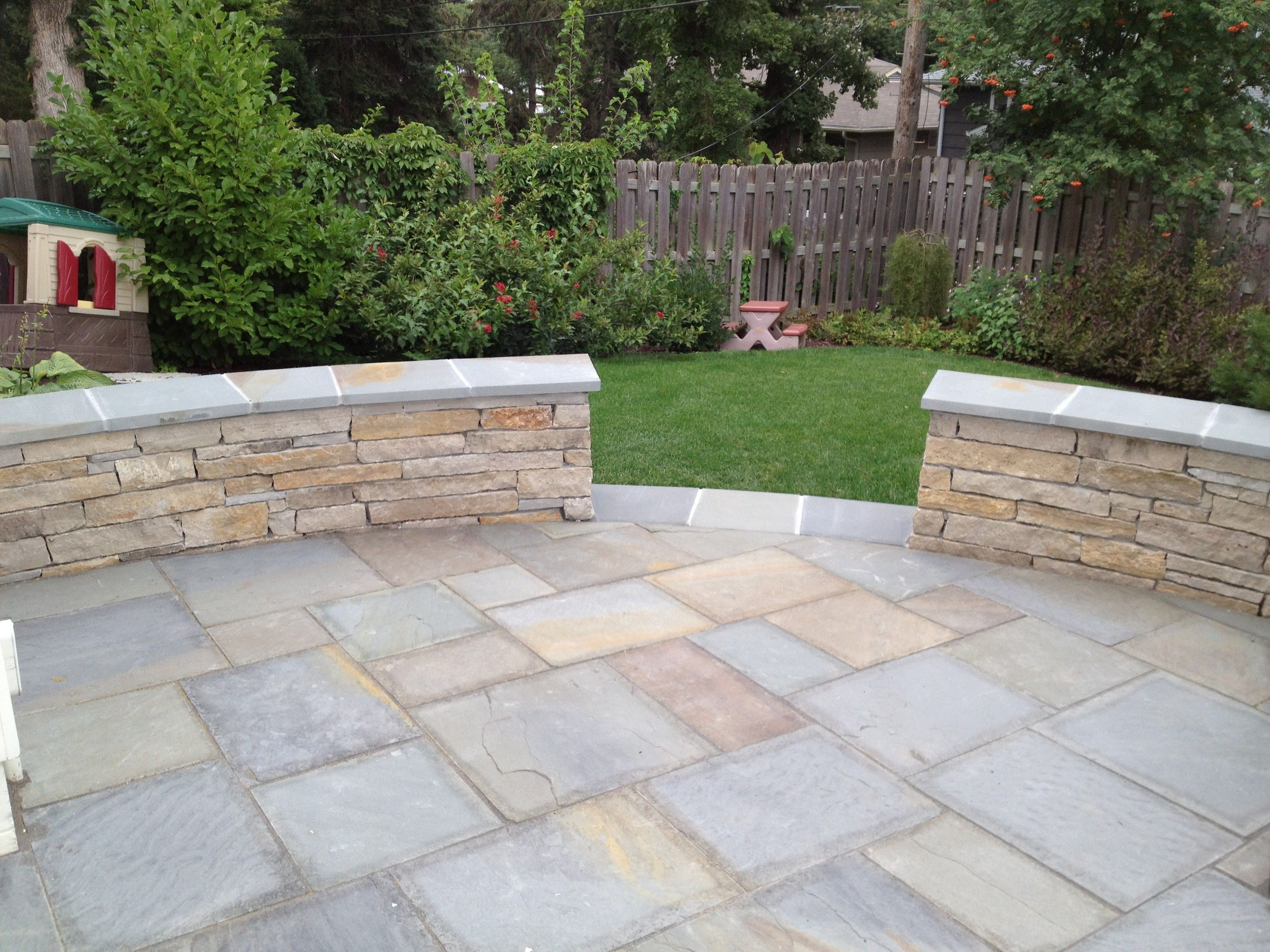 Bluestone Patio With Fond Du Lac Weathered Edge Sitting Walls