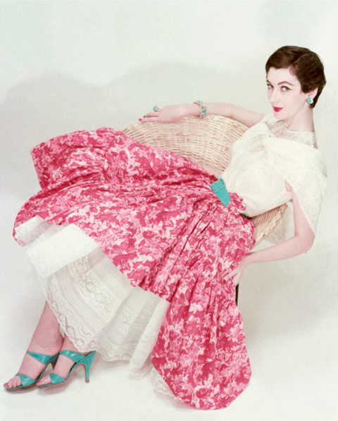 Photo by Erwin Blumenfeld, 1954, Dovima Reclines in Straw Chair, Vogue cover May.