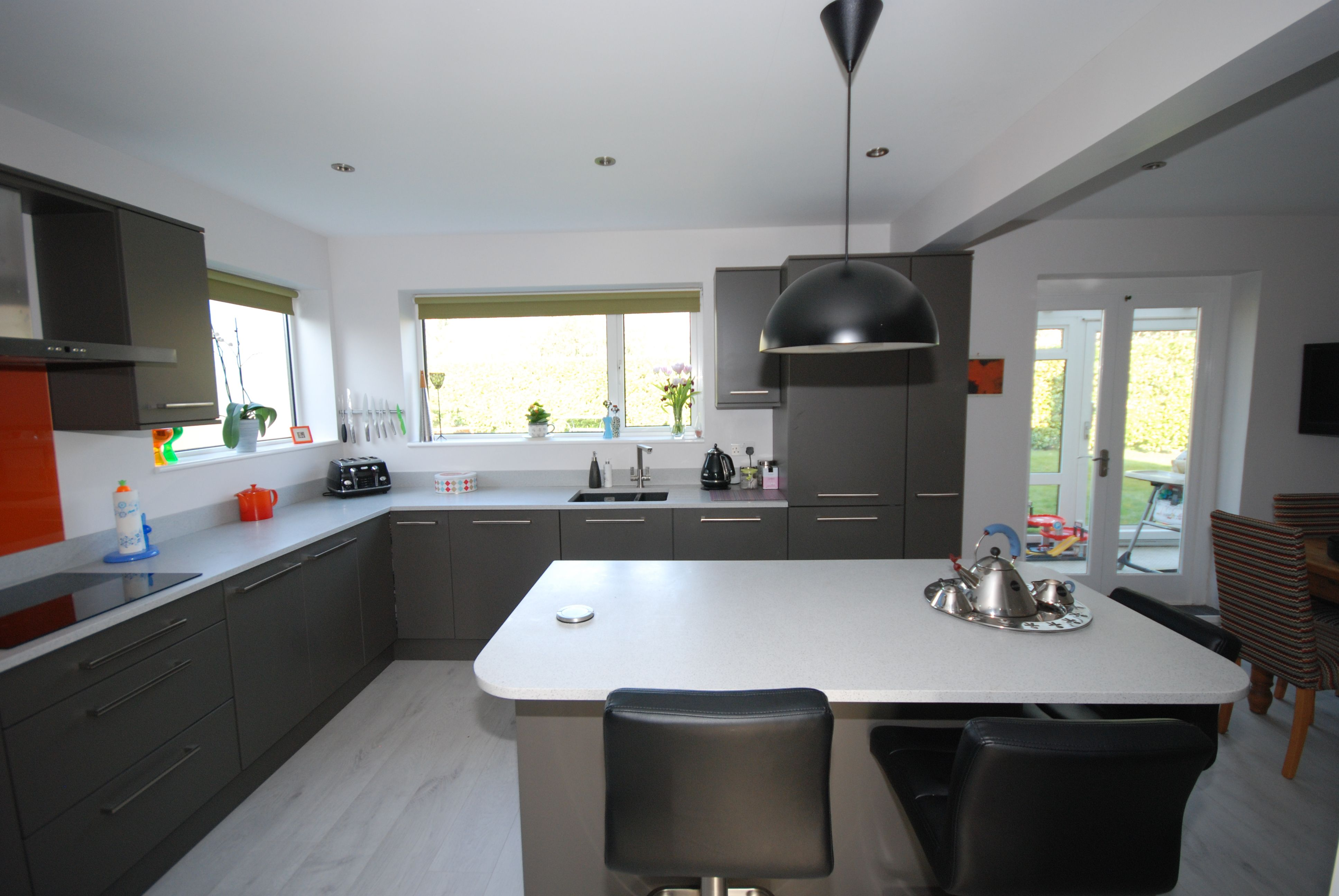 Best Lava Grey Kitchen With White Mistral Worksurface And Burnt 400 x 300