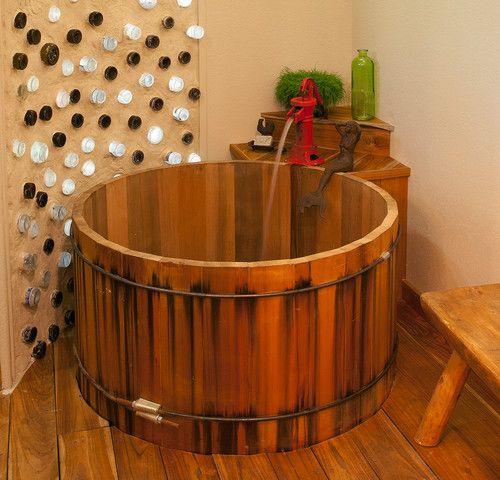 This cedar hot tub was repurposed into the everyday bathtub. Rustic ...