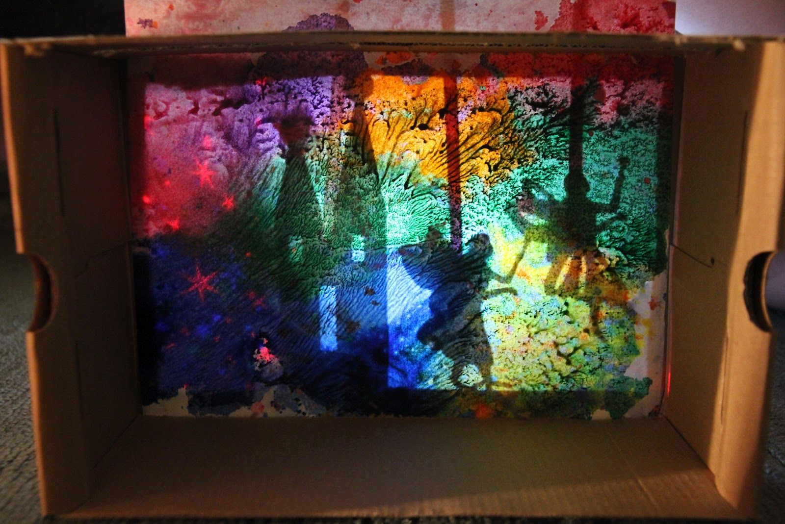 Shadow boxes with melted crayon shavings as the shadow paper. Beautiful and whimsical!