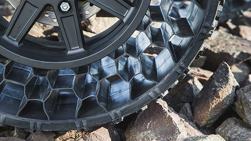 Non Pneumatic Tires Finally Hit The Commercial Sector Will Polaris Roll Over Compeion