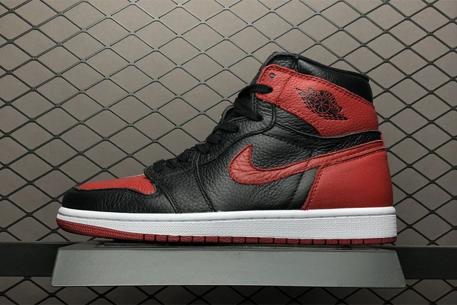 """big sale 1d58d 4af27 The Air Jordan 1 """"Homage To Home,"""" a unique split design that draws  inspiration from both the """"Bred"""" Jordan 1s and the """"Chicago"""" Jordan 1s."""