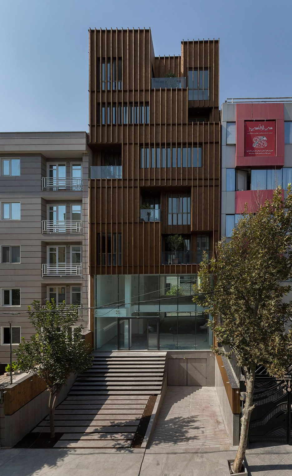 office facades. lp2 completes office block with louvred wooden facades e
