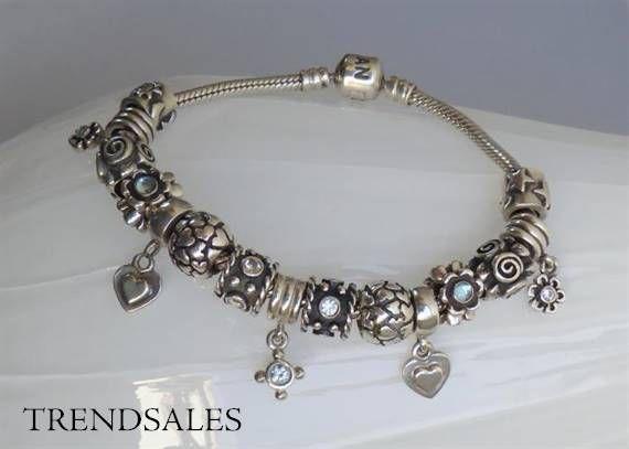 Pandora - bracelet with blue topaz flower charms no. 790279BTP