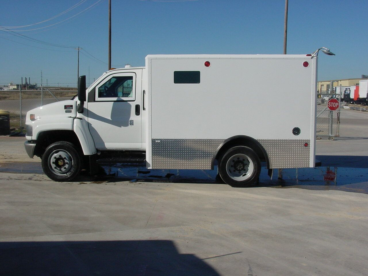 Armored truck and armored vehicle providing armored transport ...