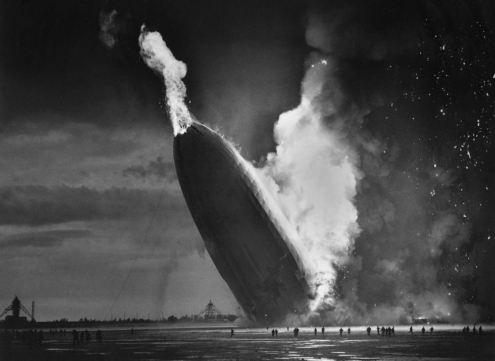The zeppelin Hindenburg crashes to the ground in Lakehurst, New Jersey, May 6, 1937. Photo by Murray Becker.
