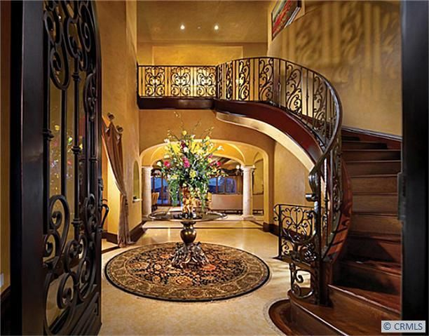 Love this entry way and staircase!
