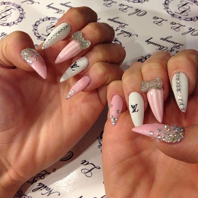 Stiletto nails♥ pink white stones...love everything except the LV ...
