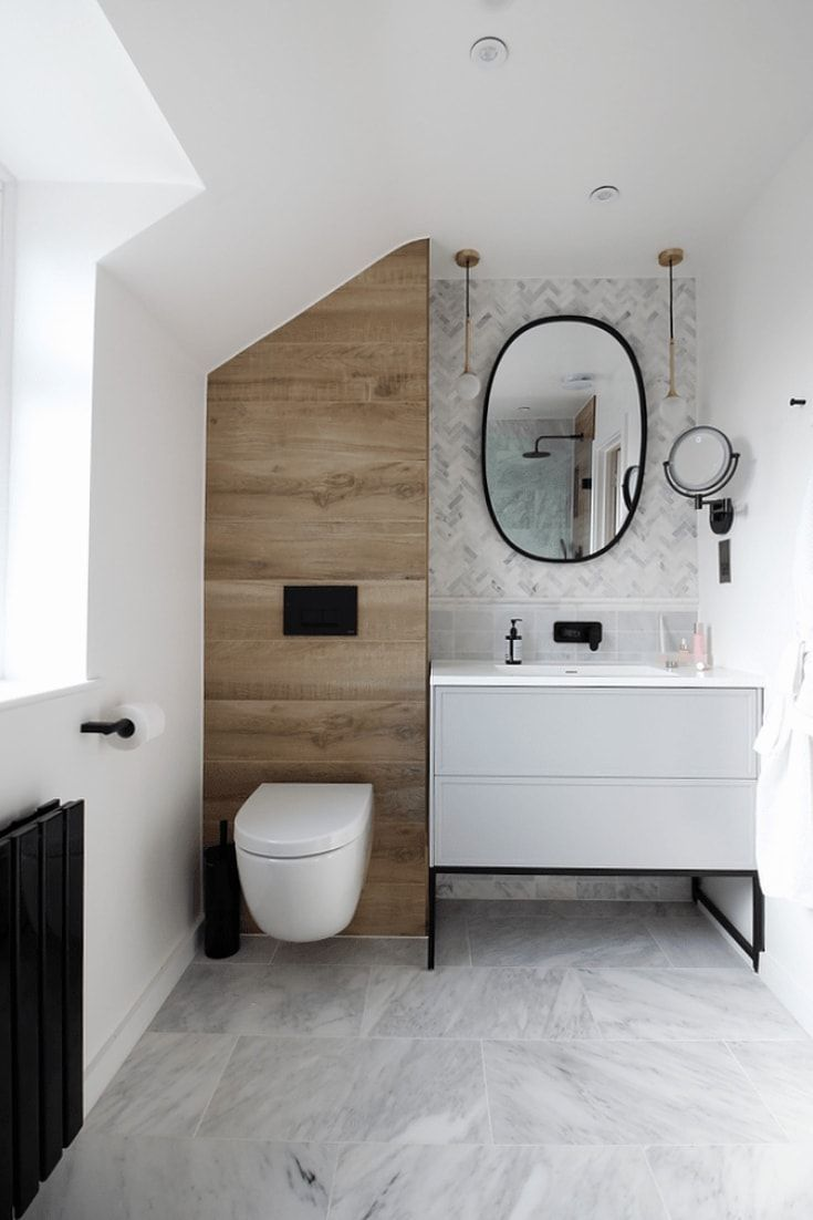 Photo of Modern Marble and Wood Bathroom with Black Accents