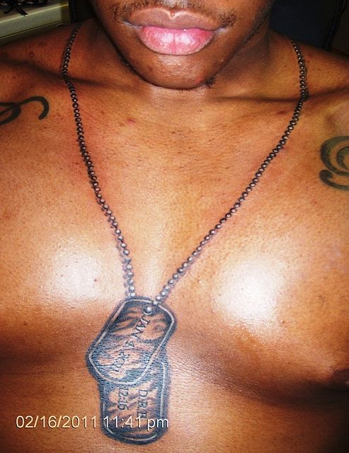 9123f00e0 Dog Tags around neck and on chest. by conspiracy ink tattoos, via Flickr .