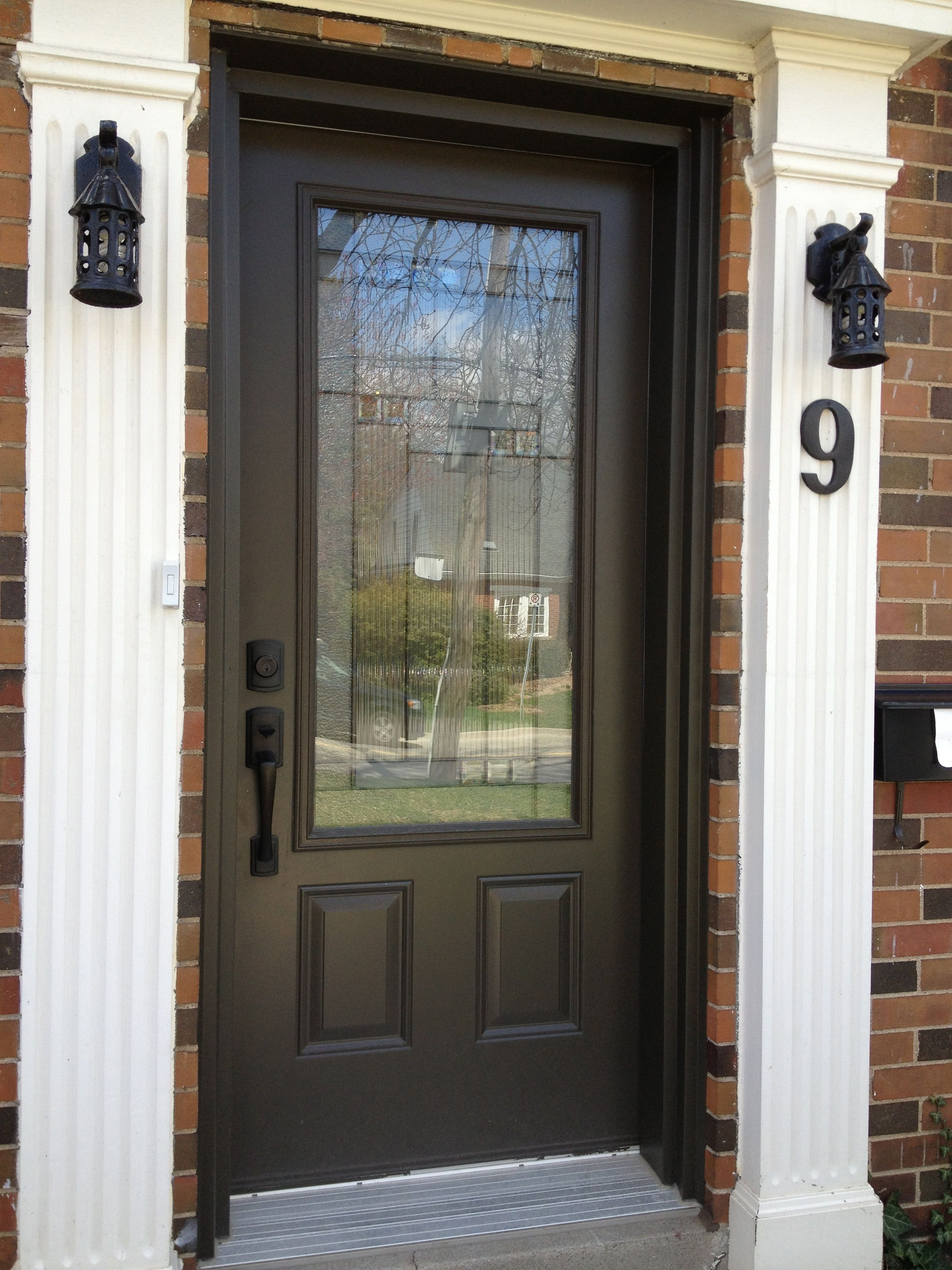 Attractive Beauteous Dark Brown Color Wooden Front Door With Glass Also Bronze Color  Metal Handles And Orange Color Bricks Wall With Leaded Glass Front Doors  Plus ... Amazing Pictures