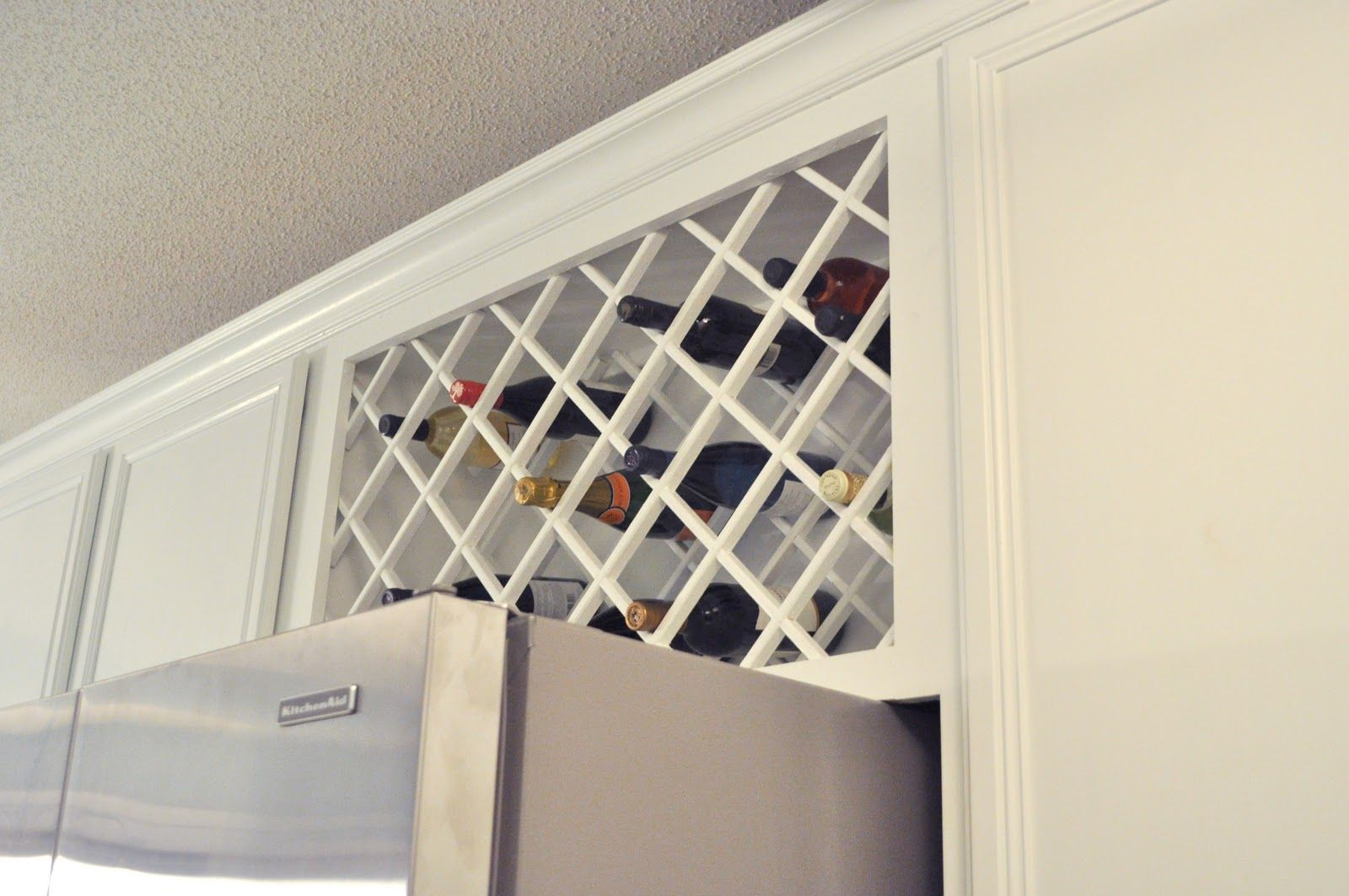 Not So Newlywed Mcgees Cabinet Wine Lattice Kitchen Cabinet Wine Rack Diy Kitchen Storage Kitchen Wine Rack