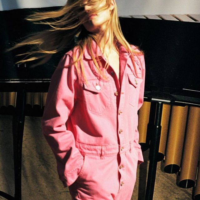 59703affdb0 This hot pink denim jumpsuit is on our wishlist Check out our list of  jumpsuits on