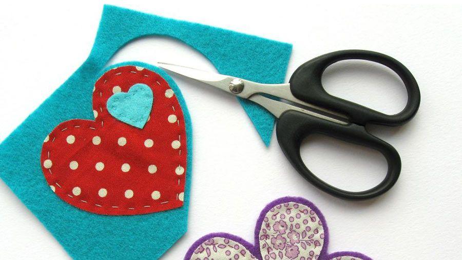 Scissors cutting out colourful felt   Fabric and felt brooches   Tesco Living