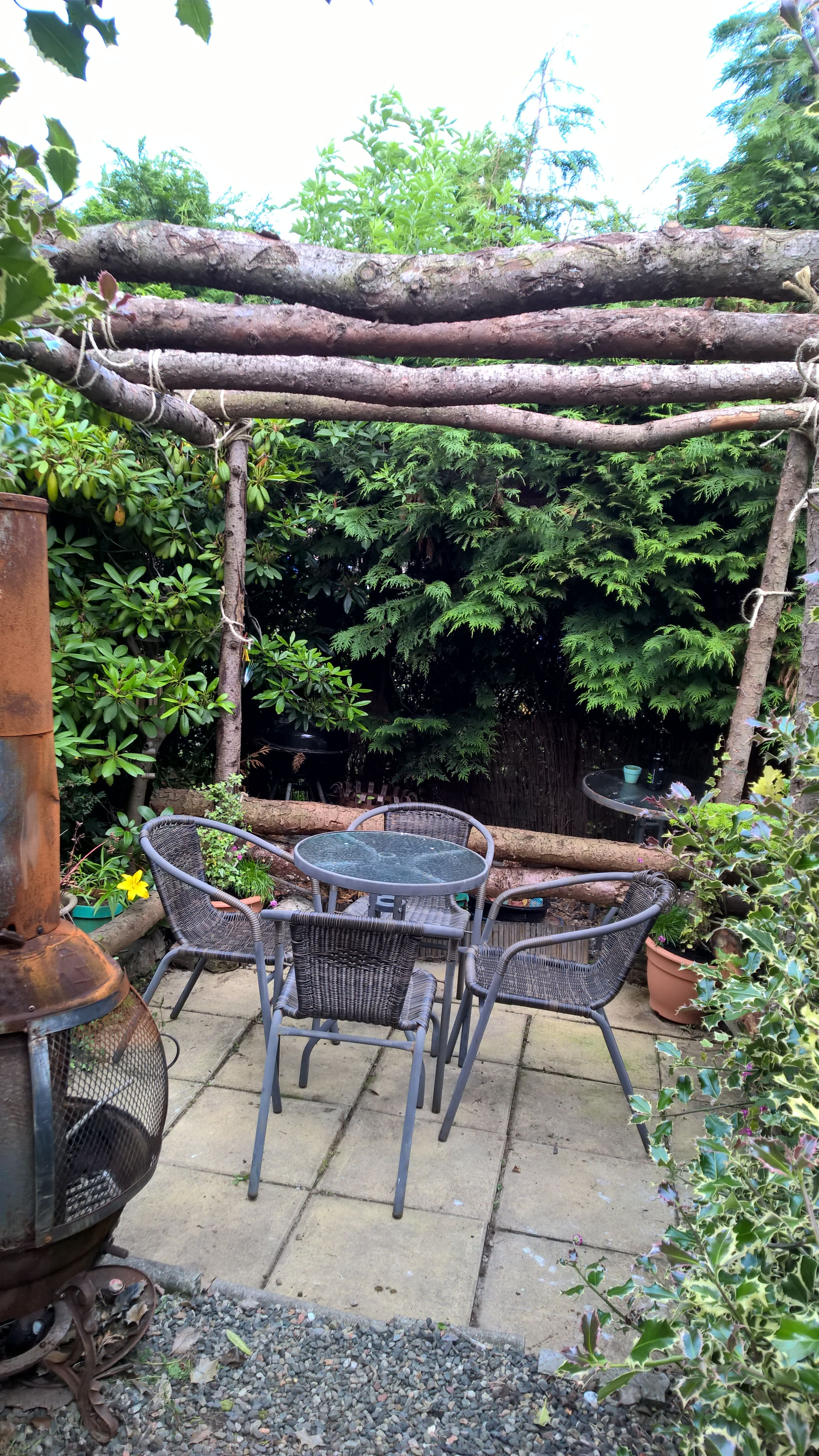 Rustic Pergola Made With Logs And Rope I Got The Logs For Free Sank Them Into Plastic Plant Pots Two Thirds Full Of Post Cement Topped With Soil And Clim Tuin