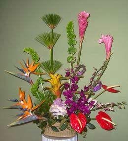 tropical flower arrangement of birds of paradise, ginger, orchids, anthurium